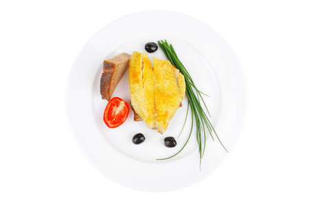 main portion: served roast golden fish fillet over white plate with tomatoes and olives photo