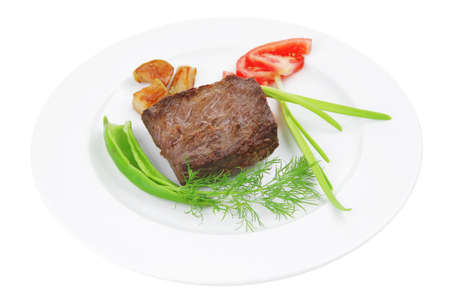 meat food : roasted fillet mignon on white plate with tomatoes apples and chili pepper isolated over white background Stock Photo - 13314776