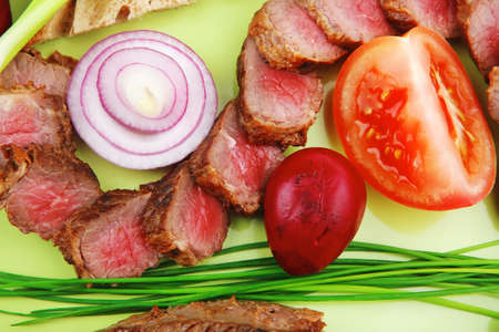 meat food : grilled fat meat served on green plate with tomatoes and sprouts isolated on white background Stock Photo - 13316608
