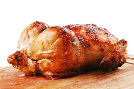poultry : homemade roast whole turkey on wooden cutting board isolated over white background Banque d'images