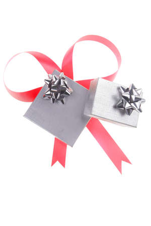 silver gift box with pink bow isolated over white background Stock Photo - 13314764