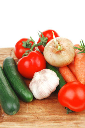 Composition with raw vegetables on kitchen cut board isolated over white background Standard-Bild