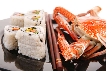 Roll with Cucumber , Cream Cheese with raw Tuna and Salmon inside. on black dish with boiled crab . Japanese traditional Cuisine Stock Photo - 13423746