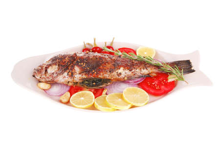 fryed: main course: whole fryed sunfish on plate with lemons and peppers