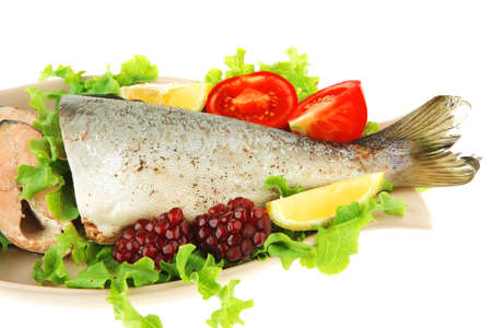 fine fish: pink salmon and vegetables served on plate Stock Photo