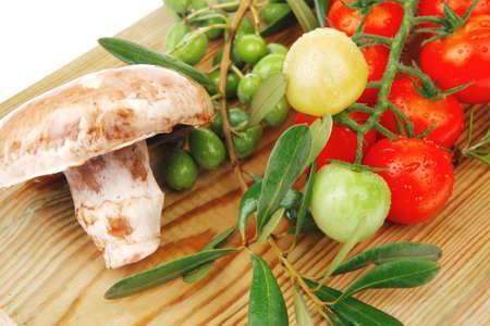 fresh prepared raw vegetables on cutting board photo