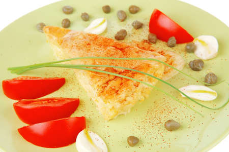 food : vegetable casserole triangle on green plate with cheese and tomatoes isolated on white Stock Photo - 13423871