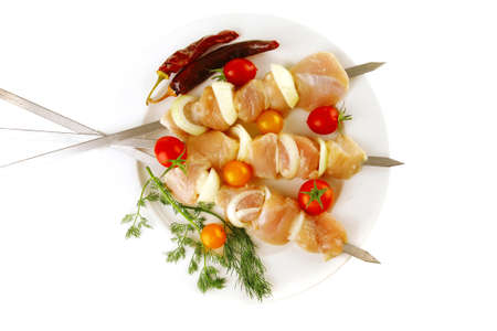 chicken shish kebab served on white plate photo