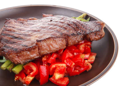meat table : grilled beef fillet with asparagus and tomatoes served on dish isolated over white Stock Photo - 13477782
