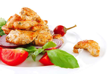 image of chicken meat and vegetables on plate photo