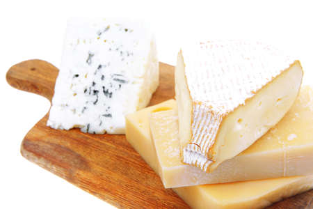 vaus types of solid french cheese parmesan brie and edam on wooden platter isolated on white background Stock Photo - 13519499