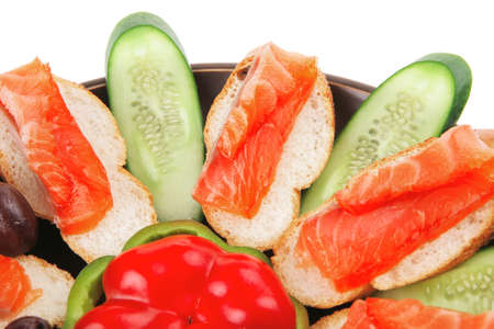 small salmon sandwiches served with vegetables Stock Photo - 13519528