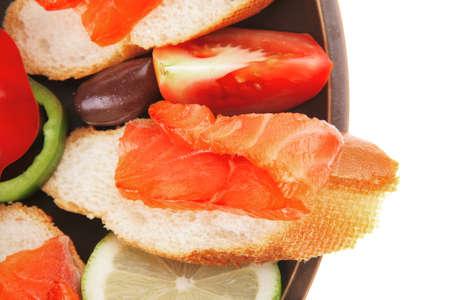 fresh vegetables with salmon on dark dish photo