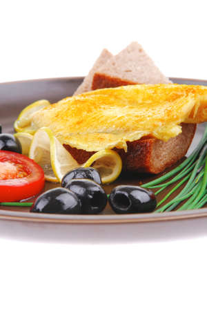 roast fish fillet with tomatoes,chives and bread on plate Stock Photo - 13633911