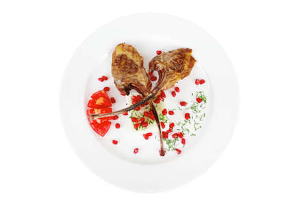 meat portion: barbecued ribs served with rice and tomatoes on plate over white background photo