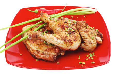 meat food : grilled quarter chicken garnished with green sprouts and red peppers on red plate isolated over white background Stock Photo - 13633774