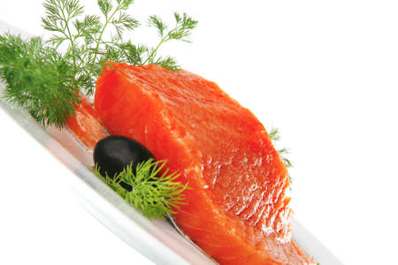 smoked fresh salmon piece with olives and fennel photo