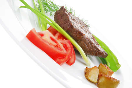 meat savory : grilled beef fillet mignon on white plate with tomatoes apples and pepper isolated over white background Stock Photo - 13809018