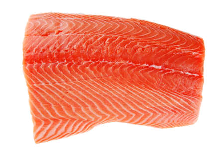 piece of big salmon fillet over white photo