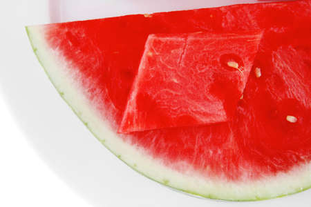 red raw watermelon pieces on white plate