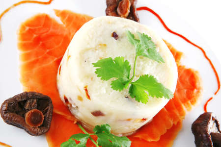 red smoked salmon with mash served on white plate