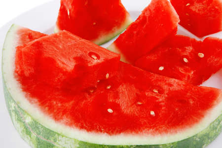 raw fresh watermelon pieces on white plate