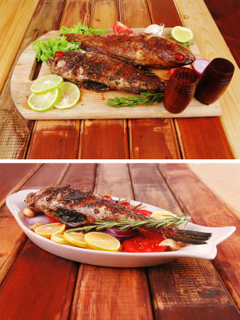 castors: roasted sea fish and castors on wood with tomatoes, lemon and green lettuce salad