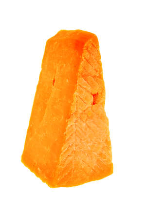 cheez: piece of cheddar cheese isolated on a white background
