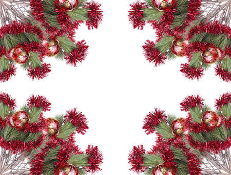 metallic christmas holiday toys with shiny red garland on fir tree twig isolated over white background photo