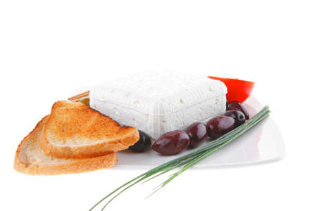 feta and olives with toast and tomatoes photo