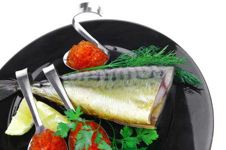 image of smoked mackerel on black plate with caviar Stock Photo - 14160299