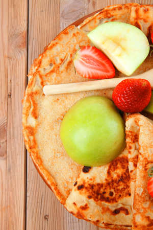 baked food : pancake with honey strawberries and apple on wooden table Stock Photo - 14160336