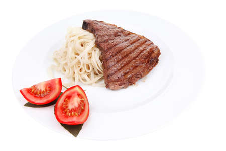 italian food : pasta with tomato on basil and roasted sirloin beef  steak on plate isolated over white background Stock Photo - 14159231