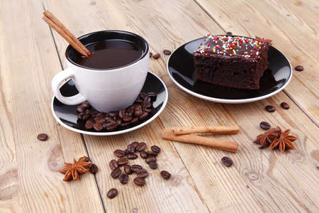 sweet food : black fragrant coffee and chocolate cake with cinnamon , coffee beans, and anise star photo
