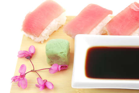 Nigiri Sushi - Set of Nigiri sushi topped with raw Tuna (maguro) . Isolated over white background . on wooden board Stock Photo - 14267107