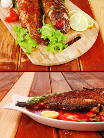 sunfish: main course: whole fryed sunfish on wooden table with lemons and peppers Stock Photo