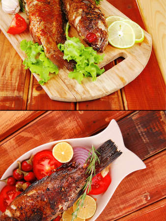 main course: whole fried seabass served on wood with lemons,tomatoes and peppers Stock Photo - 14266858