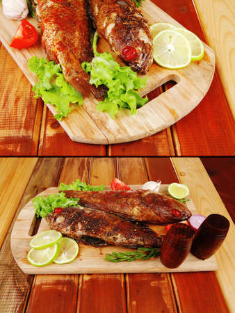 roasted sea fish and castors on wood with tomatoes, lemon and green lettuce salad photo