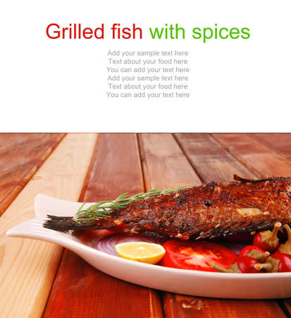 castors: main portion of two grilled fish served on wooden table with castors Stock Photo