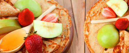 sweet food : big thin pancake with honey strawberries and apple on wooden table Stock Photo - 14266705