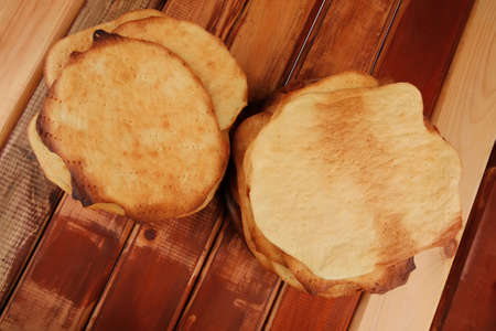 pile of hot baked cakes served on wooden plate Stock Photo - 14313604