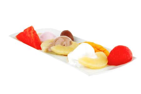 melt ice cream and gruits on plate photo