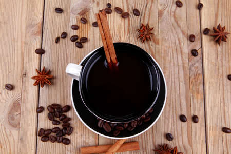 sweet food : hot black fragrant coffee and chocolate cake with cinnamon sticks, coffee beans, and anise star photo