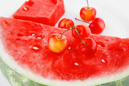 fresh raw watermelon and cherry on white plate photo