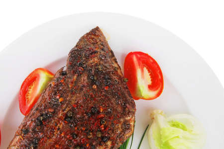 savory on white plate: grilled meat shoulder with tomato and chives isolated on white background photo