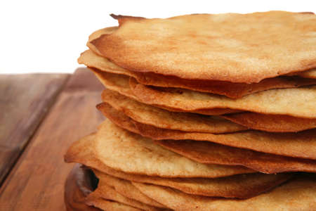 big pile of baked cakes over wooden table Stock Photo - 14400951
