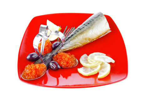 caviar and smoked fish with lemon on red plate photo