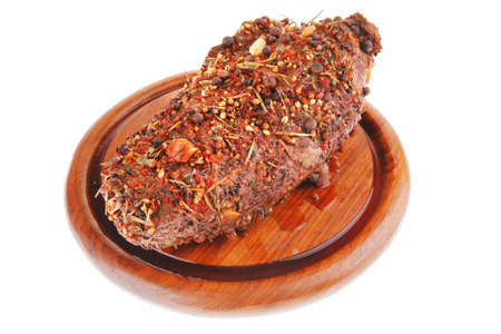 grilled beef meat in spices over white photo
