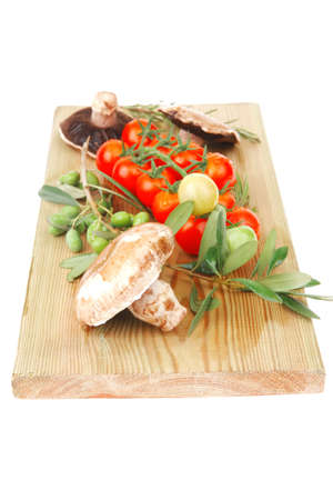 vegetables on cutting board over white background photo