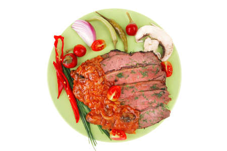 beef slices on plate isolated over white photo